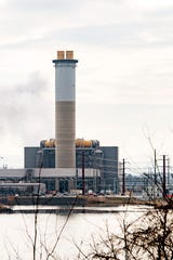 The Duke Energy power plant is seen from across Lake Julian on Jan. 30, 2020. The plant was primarily burning coal but switched to natural gas on Jan. 29, 2020.
