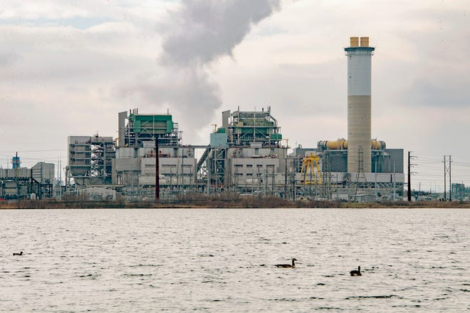 The Duke Energy power plant is seen from across Lake Julian on Jan. 30, 2020. The plant was primarily burning coal but switched to natural gas on Jan. 29, 2020. The company is demolishing the former coal operation.