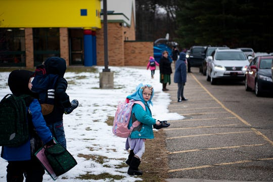 Kindergartener Rose Game-Brown walks to her ride after school at Pennfield's Purdy Elementary School on Wednesday, Jan. 29, 2020 in Battle Creek, Mich. The district is considering a $22 million bond to improve facilities.