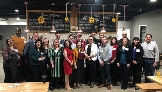 Leadership Kitsap's 20 Under 40 Class of 2020 at a networking event at Crane's Castle Brewery in January.