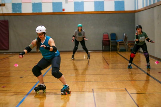 """Christina """"Scuttlebutt Jibber Jabber"""" Schlarb, left, Jessica """"Philly Buster"""" Phares, middle, and Kirstie """"Hits and Giggles"""" Williams, right, glide back and forth during a training exercise at their practice on Jan. 28."""