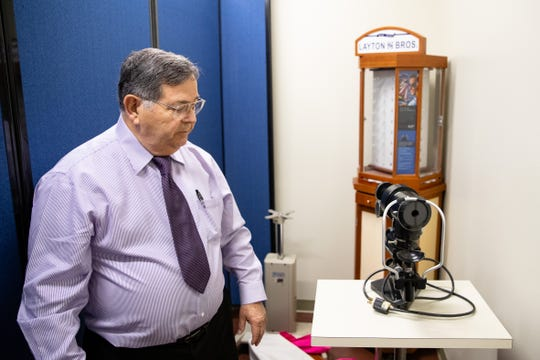 Dr. Arnoldo Villarreal explains how a keratometer works in Mission of Mercy the eye exam room during an open house on Thursday, Jan. 30, 2020.