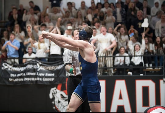 Collingswood's Andy Clark celebrates after pinning Haddonfield's Aidan Barr during the 160 lb. bout of the wrestling match held at Haddonfield High School on Wednesday, January 29, 2020.  Clark  earned his 138th career win and tied Haddonfield's wrestling coach Eric Hamrick, for the Collingswood all-time win record, with the victory.