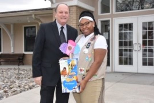 Bryana Turner celebrates getting her photo on the redesigned package of Girl Scout Shortbread cookies with Lindenwold Mayor Richard E. Roach Jr.