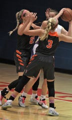 Ryle senior Maddie Scherr and junior Brie Crittendon trap the ball as Ryle defeated Conner 84-66 in girls basketball Jan. 29, 2020 at Conner HS, Hebron, Ky. Ryle senior Maddie Scherr, named Northern Kentucky's first McDonald's All-American last week, became Ryle's all-time leading scorer late in the game.
