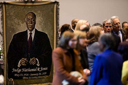 A tapestry hangs in remembrance of Judge Nathaniel Jones as people wait in the visitation line on Wednesday, Jan. 29, 2020, at Corinthian Baptist Church in Bond Hill. Jones, 93, died of congestive heart failure Sunday at his East Walnut Hills home.