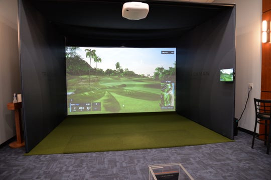 "The Golf Den at The Club at Woodbridge Sports and Fitness Center allows patrons to play courses all over the world."" ."
