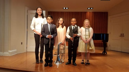 (Left to right): Hannah Yin, Pratham Gandhi, Anna Bao, Tawanda Sibanda and Emily O'Neill with their instruments in Rutgers University's Schare Hall.