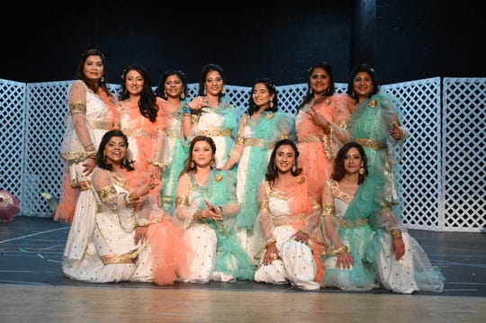 The Desi Moms pose for a group photo after their show stopping finale at International Family Fun Night.