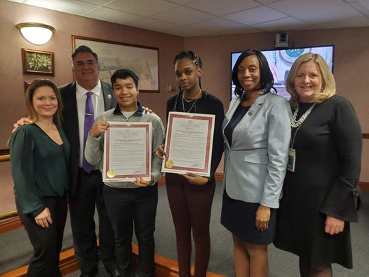 Representatives from the Red Team are presented with a resolution from the Freeholder Board for winning the UC Step Summit. Pictured are (left to right): Deana Mesaros from the Union County Office of Business Development, Freeholder Chairman Alexander Mirabella, Freeholder Angela Garretson and Deputy County Manager Amy Wagner.