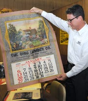 Greg Coffman holds a 1929 calendar designed and printed at The Novelty Advertising Company in this 2012 Tribune file photo.