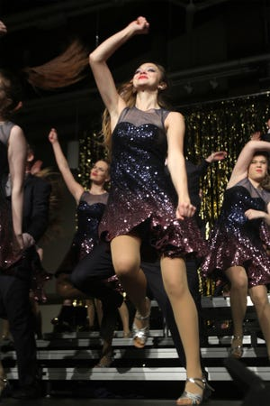 Members of the Side One Show Choir work on their show. The Indianola High School Flip Side and Side One show choirs held a dress rehearsal on Jan. 27 for their annual Cabaret.