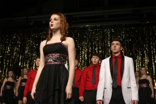 Members of the Flip Side Show Choir work on their show. The Indianola High School Flip Side and Side One show choirs held a dress rehearsal on Jan. 27 for their annual Cabaret.