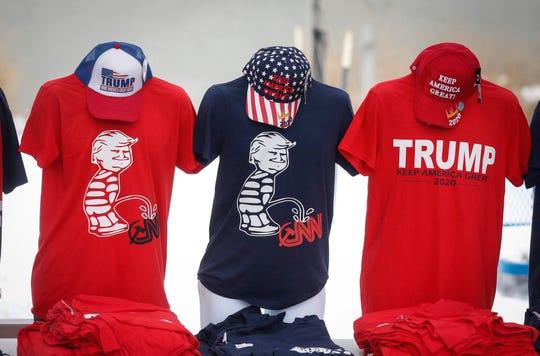 Merchandise for sale outside the Knapp Center in Des Moines, where President Donald Trump will speak Thursday night.
