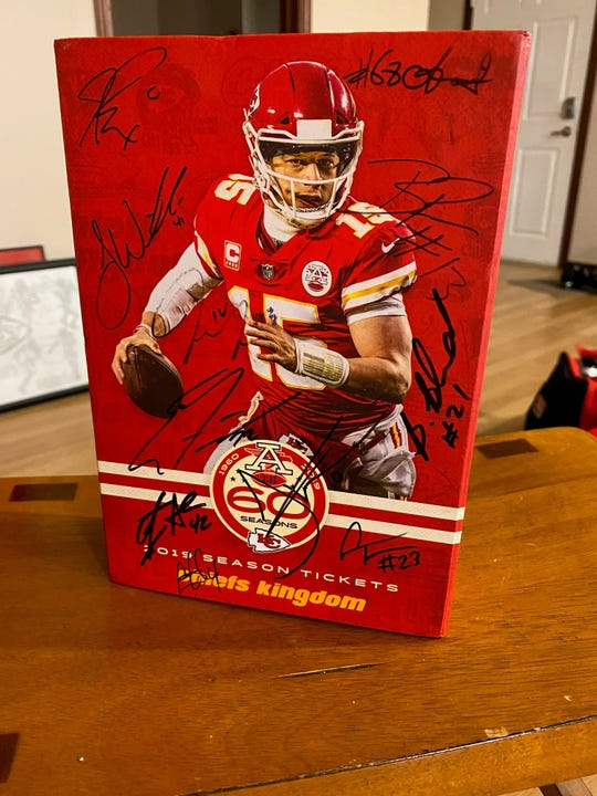 Kansas City Chiefs quarterback Patrick Mahomes is featured on the team's commemorative box for 2019 season tickets. Pleasant Hill resident Rich Schmadeke obtained autographs numbering in the double digits from Chiefs players this season. The team has reached the Super Bowl for the first time in 50 years.