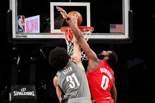 Detroit Pistons center Andre Drummond (0) fouls Brooklyn Nets center Jarrett Allen (31) who dunks during the first half of an NBA basketball game, Wednesday, Jan. 29, 2020, in New York. (AP Photo/Kathy Willens)