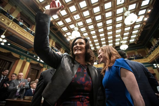 Governor Gretchen Whitmer waves before delivering her State of the State address at the State Capitol in Lansing, Wednesday, Jan. 29, 2020.
