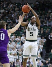 Michigan State guard Cassius Winston (5) shoots against Northwestern forward Miller Kopp (10) on Jan. 29, 2020 at the Breslin Center in East Lansing.