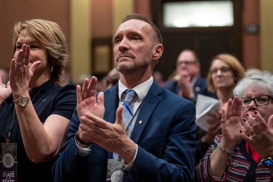 Oakland County Executive Dave Coulter applauds for Governor Gretchen Whitmer during the State of the State address at the State Capitol in Lansing, Wednesday, Jan. 29, 2020.