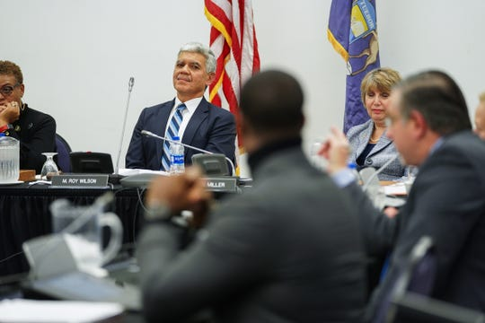 Wayne State University President M. Roy Wilson listens to Wayne State University Board of Governors member Michael Busuito comment during a public meeting at McGregor Memorial Conference Center - Alumni House on the Wayne State University campus in Detroit on Friday, December 6, 2019.