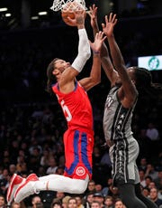 Pistons guard Derrick Rose (25) goes up against Nets forward Taurean Prince (2) during the first half on Jan. 29, 2020.