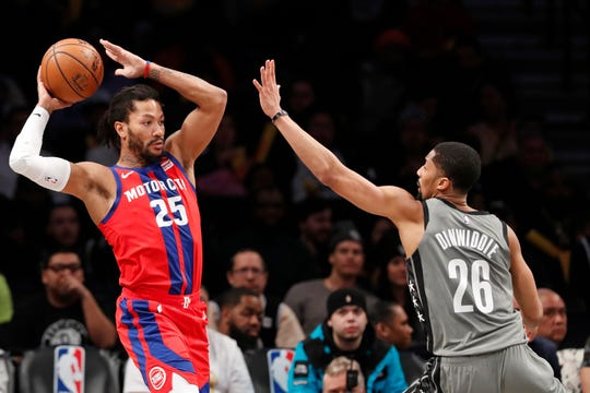 Detroit Pistons Derrick Rose (25) passes around Brooklyn Nets guard Spencer Dinwiddie (26) during the second half of an NBA basketball game, Wednesday, Jan. 29, 2020, in New York. The Nets defeated the Pistons 125-115. (AP Photo/Kathy Willens)
