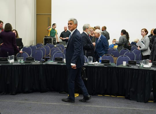Wilson prepares to leave following a public meeting of the Wayne State University Board of Governors at McGregor Memorial Conference Center in December.