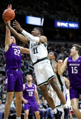 Michigan State forward Aaron Henry (11) drives against Northwestern forward Pete Nance (22) on Jan. 29, 2020, at the Breslin Center in East Lansing.