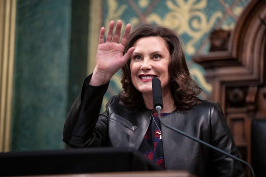 Governor Gretchen Whitmer waves at her guests as she delivers the State of the State address at the State Capitol in Lansing, Wednesday, Jan. 29, 2020.