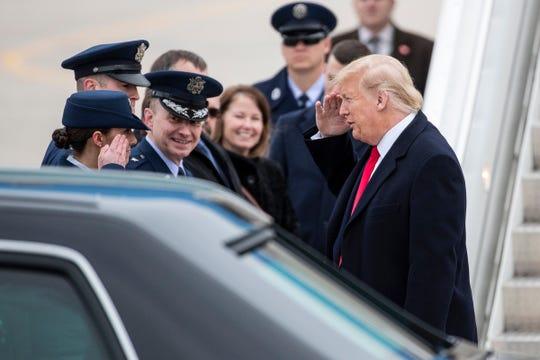 President Donald Trump salutes to Senior Airman Jenna Gleason at Selfridge Air National Guard Base in Harrison Township, Thursday, Jan. 30, 2020.