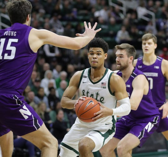 Malik Hall passes against Northwestern during the first half of MSU's 79-50 win Wednesday.