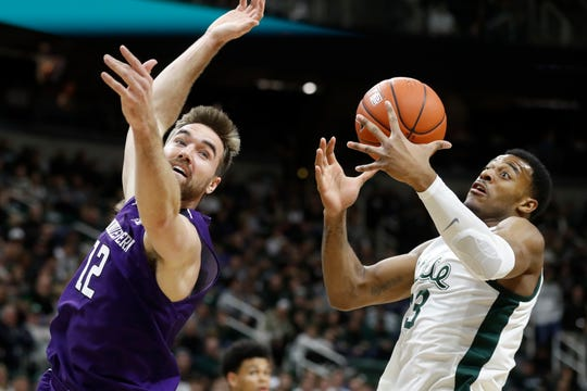 Michigan State forward Xavier Tillman (23) catches the inbound pass intended for Northwestern guard Pat Spencer (12).