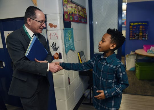 State Superintendent Michael Rice meets third grader Romane Green, 9, during a visit to Ferndale schools, recognized by the state and national organizations as a pioneer in social emotional learning.