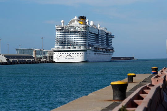 The Costa Smeralda cruise ship is docked in the Civitavecchia port near Rome, Thursday, Jan. 30, 2020. Italian health authorities are screening passengers aboard after a passenger from Macao came down with flu-like symptoms amid the global scare about a new virus. Passengers are being kept on board pending check to determine the type of virus.