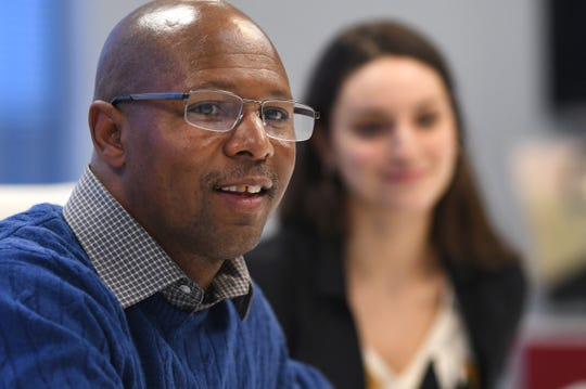 Danny Burton speaks about being released from prison last month with his attorney Madeline Sinkovich in Southfield after being exonerated for a 1987 murder in which he is accused of dumping the body of a 20-year-old man.
