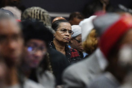 Detroit home owner Linda Walker listens in during a panel discussion on The Detroit News' investigation into Detroit homeowners being overtaxed by the city at Wayne County Community College in Detroit, Michigan on January 29, 2020.