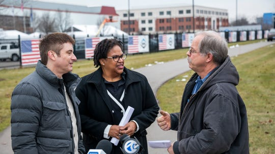 (From left) Macomb county commissioner Robert Mijac, Michigan Democratic Party chair Lavora Barnes, and Ford body technician Tony Durkacs chat before the start of a press conference about the visit by President Donald Trump in front of Dana Incorporated, in Warren January 30, 2020.
