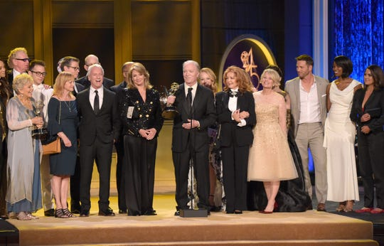 """FILE - This April 29, 2018 file photo shows Ken Corday, center, and the cast and crew of """"Days of Our Lives"""" accepting the award for outstanding drama series at the 45th annual Daytime Emmy Awards in Pasadena, Calif."""