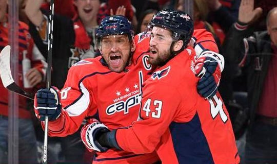 Capitals forward Alex Ovechkin, left, celebrates his goal with former Plymouth Whaler Tom Wilson during Wednesday's 5-4 loss against the Predators in Washington.