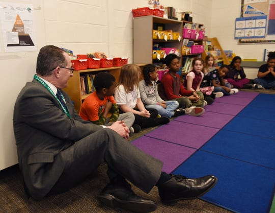 State Superintendent Dr. Michael F. Rice observes a third grade class activity during his visit at Ferndale Upper Elementary School.