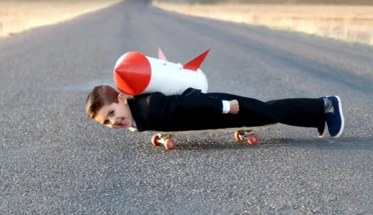 A Super Bowl commercial from United Shore Financial Services mocks competitor Quicken Loans' Rocket Mortgage by showing a kid on the skateboard with a rocket strapped to his back at the beginning of the video.