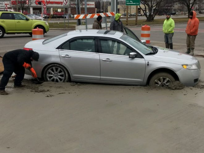 Officials with the Road Commission for Oakland County said a motorist drove around construction barricades and into freshly poured concrete.
