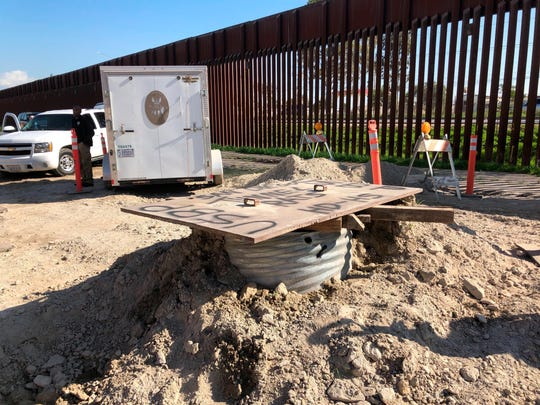A covered access point leading to a smuggling tunnel is seen on the U.S side of the border wall in San Diego, Calif. on Wednesday, Jan. 29, 2020.