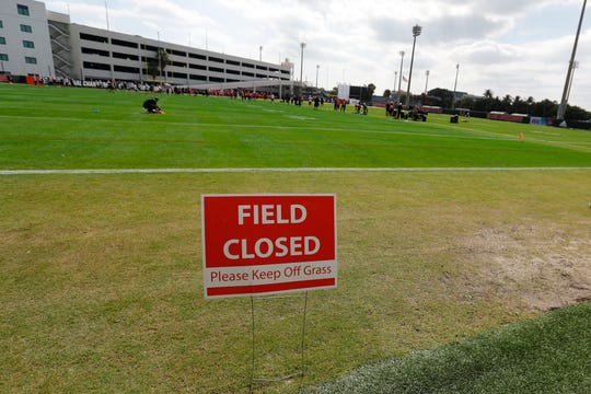 A sign at the end of the field is shown as the San Francisco 49ers warm up during practice.