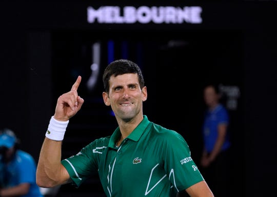 Serbia's Novak Djokovic celebrates after defeating Switzerland's Roger Federer in their semifinal match at the Australian Open.