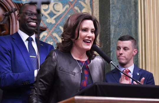 Gov. Gretchen Whitmer gives the Michigan State of the State address at the Capitol in Lansing, along with  Lt. Gov. Garlin Gilchrist II, left, and Speaker of the Michigan House Lee Chatfield, right.