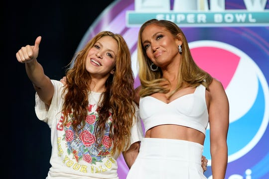 NFL Super Bowl 54 football game halftime performer Jennifer Lopez and Shakira pose for a picture after a news conference Jan. 30, 2020, in Miami.