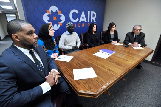 CAIR MI Executive Director Dawud Walid, CAIR attorney Amy Doukoure, plaintiffs / former co-workers Aliou Diao and Alicia Dunlap and their attorneys Channing Robinson and Michael Pitt.