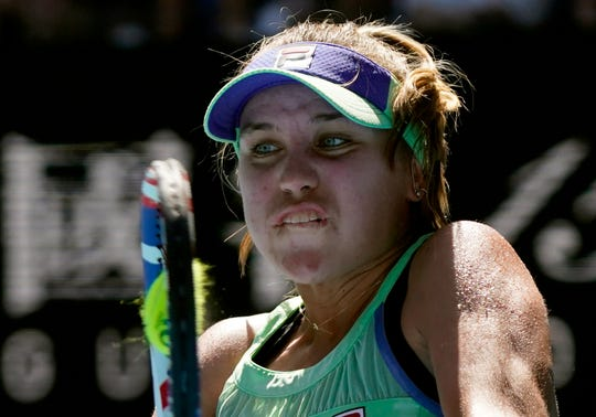 Sofia Kenin of the U.S. makes a backhand return to Australia's Ashleigh Barty during their semifinal match.