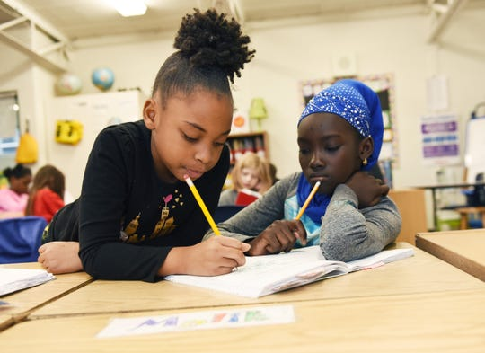 l-r, 4th graders, Ra' Niyah White, 9, and Diara Toure, 11, works on their writers workshop assignment during class at Ferndale Upper Elementary School.
